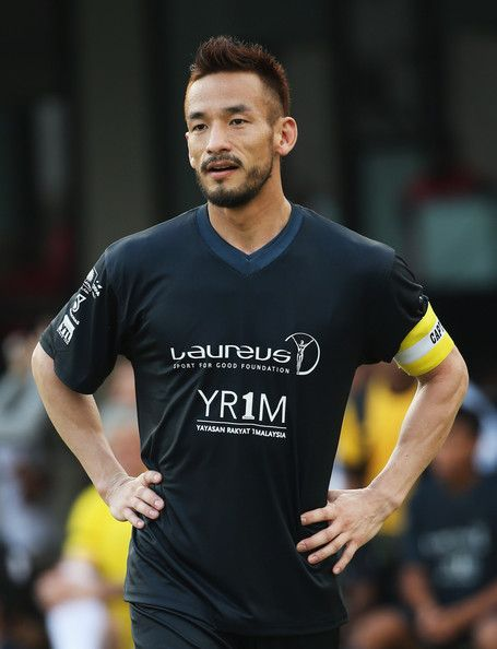 Hidetoshi Nakata Photos - Hidetoshi Nakata of Team Laureus looks on during the Laureus All Stars Unity Cup ahead of the 2014 Laureus World Sports Awards at Royal Selangor Club on March 25, 2014 in Kuala Lumpur, Malaysia. - Laureus All Stars Unity Cup