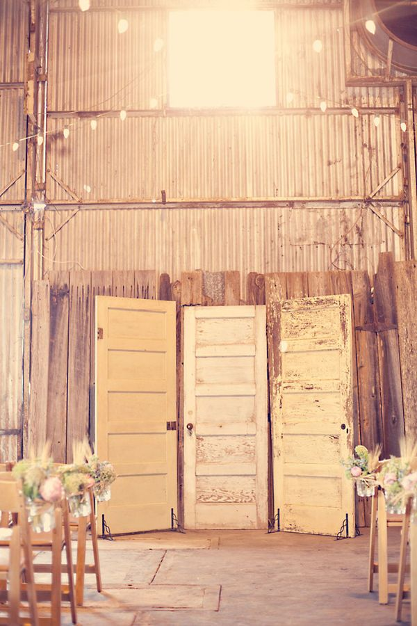 Salvaged doors as backdrop for the ceremony