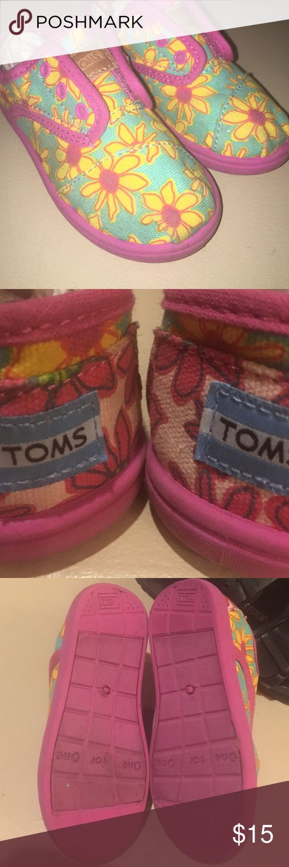 EUC Toms for girls Toddler SZ9 $45 Like new. Pink turquoise and bright yellow. Velcro hidden behind faux lace up front. Toms gives a new pair of shoes to a child in need with every pair purchased, so these shoes were a blessing to someone already. ❌trades ❌box❌tags TOMS Shoes