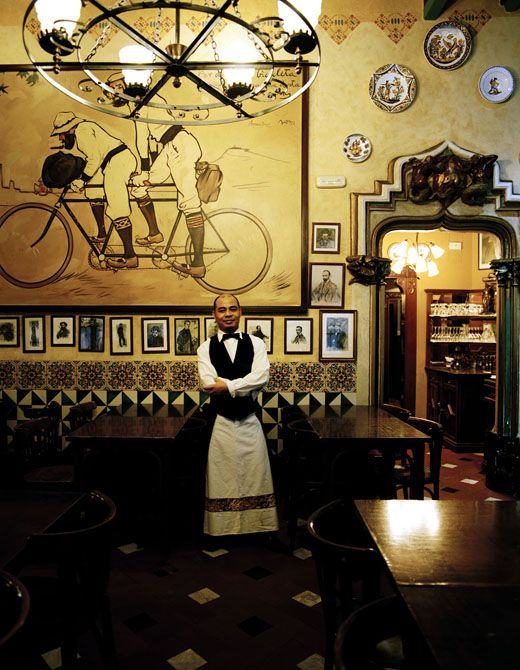 'Els 4 Gats' (The Four Cats), is a café in Barcelona opened in June 1897. Active until 1903, Els Quatre Gats became one of the main centers of Modernisme in Barcelona. The artist Ramon Casas i Carbó largely financed this bar on the ground floor of Casa Martí (1896), a building by the architect Josep Puig i Cadafalch in Carrer Montsió near the center of Barcelona.
