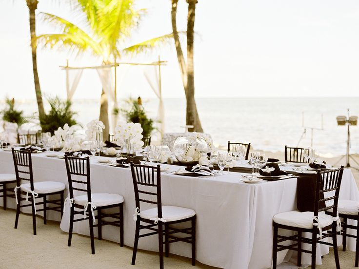 black and white beach wedding / coordination by Destination Wedding Studio / flowers by Floral Fantasy Weddings / photo by careweddings.com