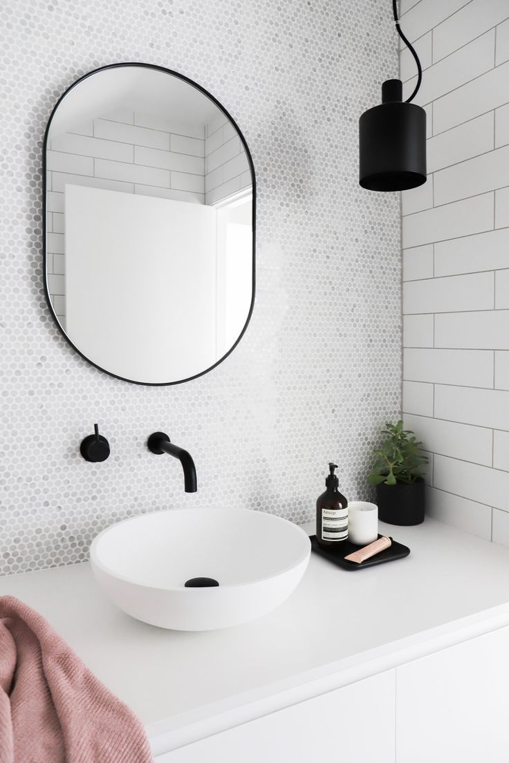 ur place oval bjorn mirror in black displayed beautifully in this bathroom desig