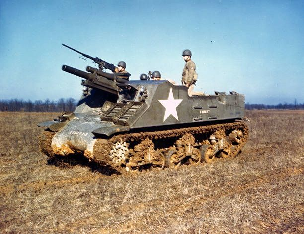 View of an American tank crew as they drive an M7 Priest self-propelled artillery vehicle through a field during stateside training, early 1940s. Pin by Paolo Marzioli