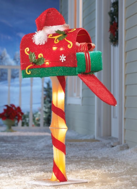 Candy Cane Lighted Santa Mailbox - This delightful decoration features a bright red mailbox topped with a Santa hat, holly leaves and snowflakes. It sits atop a candy cane striped post, has a fun wrapped gift inside and sparkles with lighted accents....  #Christmas #Christmas2014