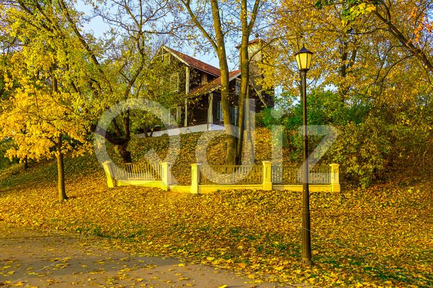 Qdiz Stock Photos Country Home on Hillock In Autumn,  #autumn #building #colorful #country #fall #fallen #fence #foliage #Hill #hillock #home #house #knoll #lamp #landscape #leaf #leaves #nature #road #season #tree #yard #yellow