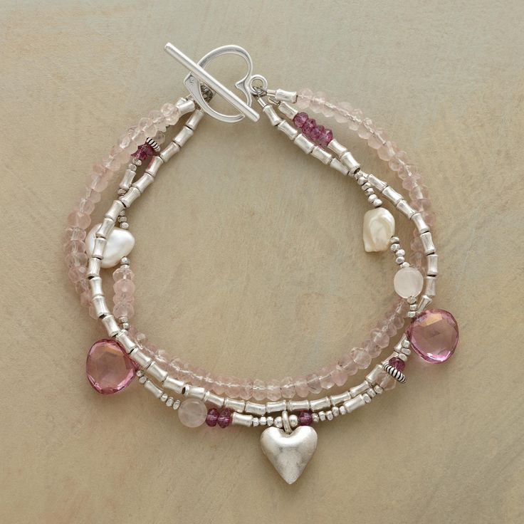 """PETAL PEARL BRACELET--Rose and pink quartz sweeten cultured white petal pearls. Three-strand bracelet kissed with heart charm and toggle. Exclusive. Handmade in USA of sterling silver. 7-1/2""""L."""
