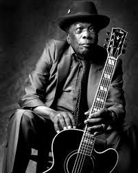 John Lee Hooker.   An American blues singer, songwriter and guitarist. He was born in Mississippi, the son of a sharecropper, and rose to prominence performing an electric guitar-style adaptation of Delta blues.