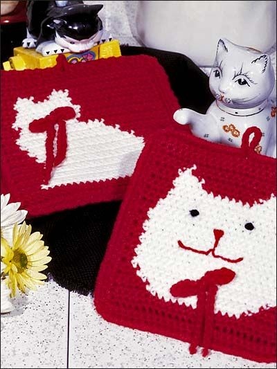 """CROCHET KITTY POTHOLDERS:  Easy-to-stitch pot holders are worked in 4-ply yarn with size G hook. Approximately 7"""" x 7"""".  Skill Level: Intermediate"""