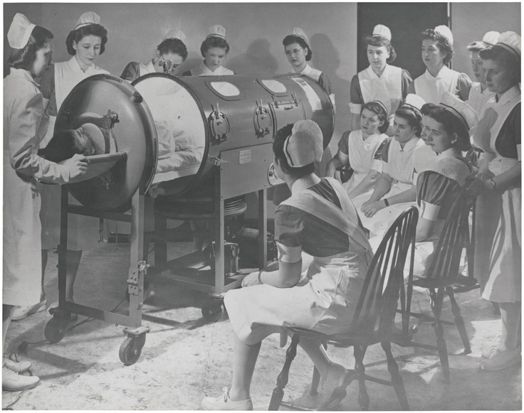 """Instructing nurses on the use of respirator for a polio patient"" 1958.  Unknown photographer/location, via National Archives. These iron lungs would soon be obsolete, thanks to Dr. Salk."
