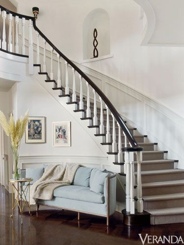 jennifer lopez home, veranda... i love the couch at the base of the stairs