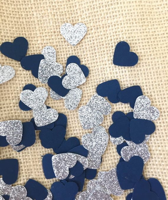 Use this navy and silver glitter confetti to decorate tables and stuff invitations. Perfect for weddings, bridal showers and baby showers! There are tons of ways to use this confetti, and all of them are sure to bring a lot of sparkle and fun to whatever the occasion might be!  Quantity: 100 pieces of hand punched confetti. Size: hearts 1 Color: navy and silver glitter (white on the back)  Please note that silver glitter hearts are ONE SIDED. The back of the hearts is WHITE.  Color might…