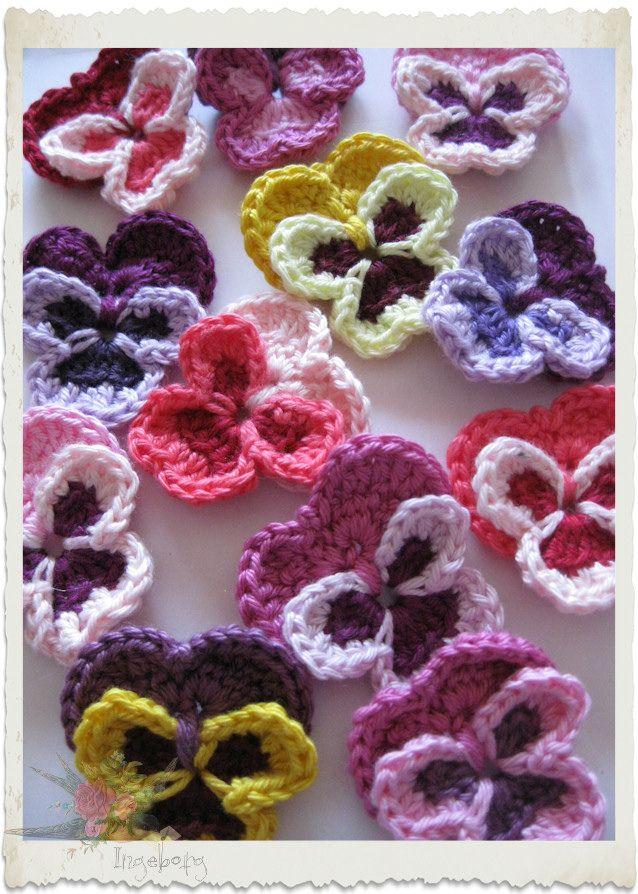 Crochet pansies by Ingeborg van Zuiden http://ingeborgvanzuiden.com or http://www.flickr.com/photos/holymountainflowerfairy/