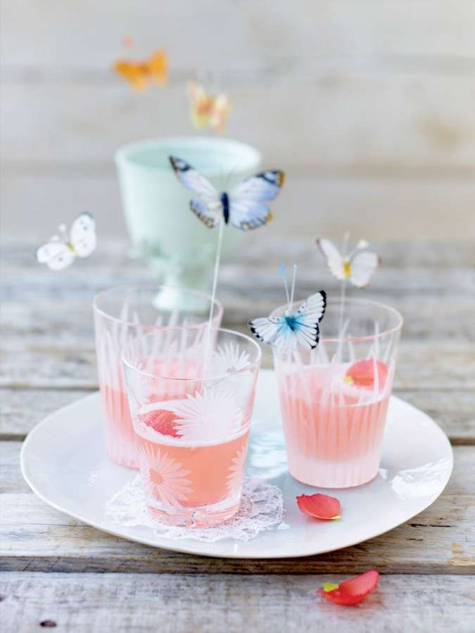 Rhubarb and poppy drink. Love the whimsical butterfly drink stirrers!