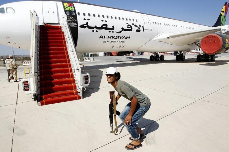 Voittaja Vuoden lehtikuvakilpailun ulkomaan reportaasien sarjassa: Tripolin valtaajat, Libya, elokuu 2011. Katso muut kilpailussa menestyneet kuvat klikkaamalla kuvaa. Kuva: Markus Jokela / HS