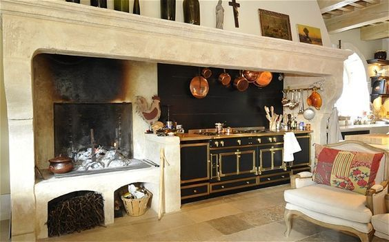 love the open fire. not sure if that would be practical but i do love the idea of a fireplace in the kitchen or great room that's close to kitchen.