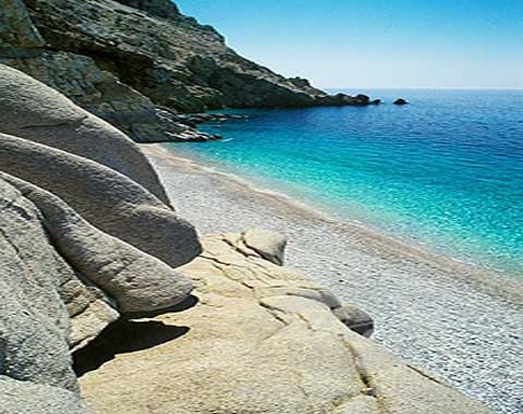 Ikaria Island, Greece  This island is not the typical Greek Island you would visit but it has a natural hot pool in the sea which is simply wonderful.  The beaches really do look this stunning and because there are very few people and hardly any tourists, you can enjoy naked swimming.  Pure heaven.