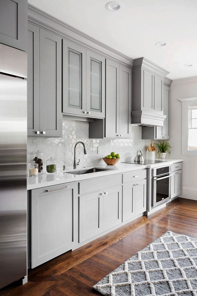 Shaker style kitchen cabinet painted in Benjamin Moore 1475 Graystone. The walls are Benjamin Moore Dove Wing.