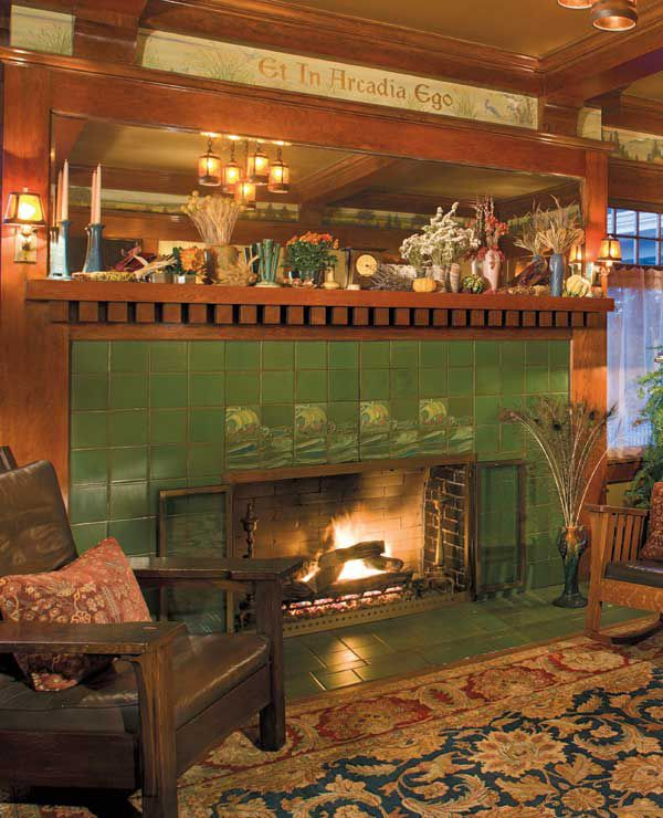 The fireplace of matte green Grueby tiles with accents was installed in 1907. (Photo: William Wright)