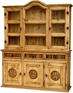 The solid pine construction of this rustic cupboard will keep your dishes and glassware safe and free of dust. The bonnet top as well as the carved star fronts and molded sides give this piece the southwestern country look that goes well with other furniture designs. Glass for the cabinet doors is now included with every rustic cupboard!  LaFuente.com