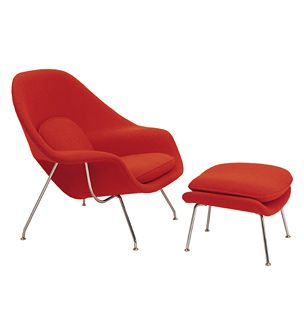 This is the Knoll Saarinen Womb Chair.  It's very comfortable and probably very expensive.
