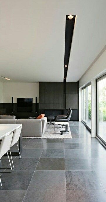 A masculine and powerful interior  His lighting details are just  brilliant do you see how the light trough drips down vertically into the  fireplace wall 33 best LIGHTING images on Pinterest   Lighting ideas  Lighting  . Recessed Track Lighting Prices. Home Design Ideas