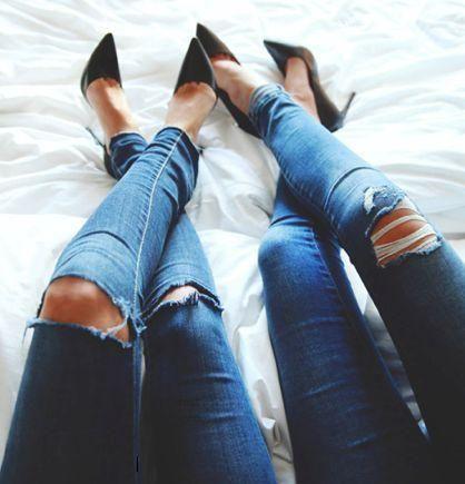 Knee-cut jeans and black stilettos