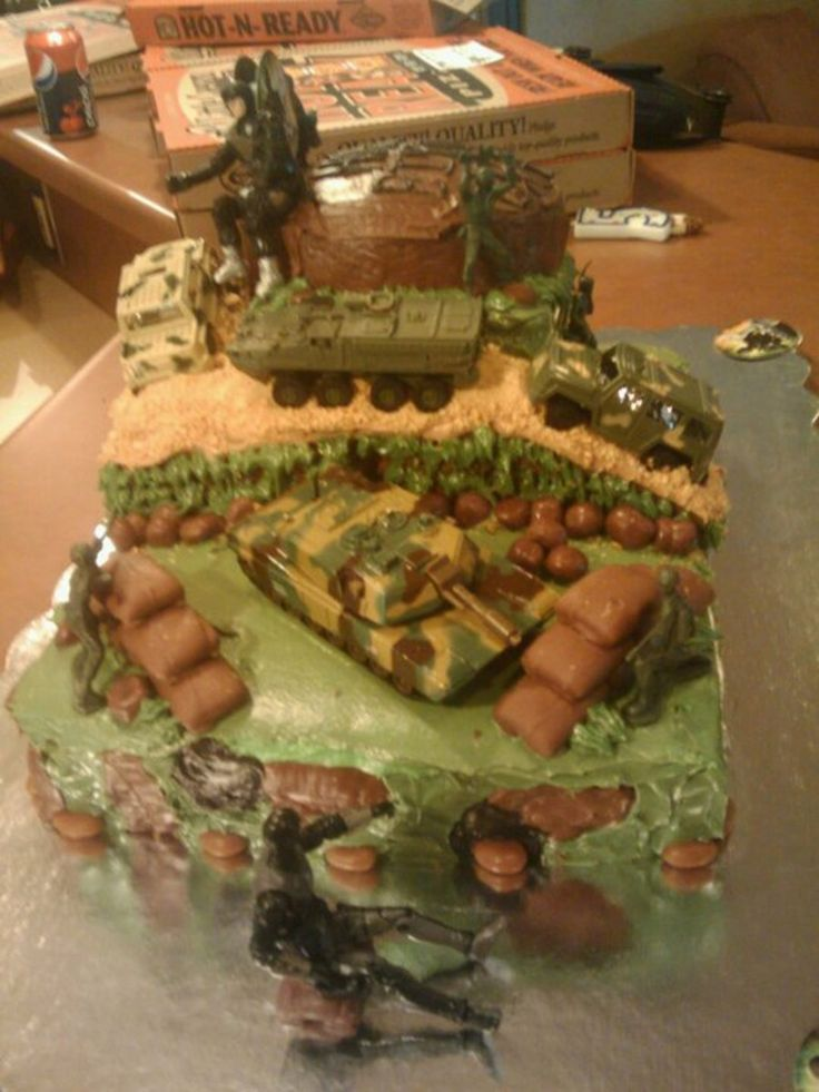 Army /g.i. Joe Cake Made this for a 5yr olds b-day. Bottom layer yellow, middle lemon, top chocolate. green shades are cream cheese...