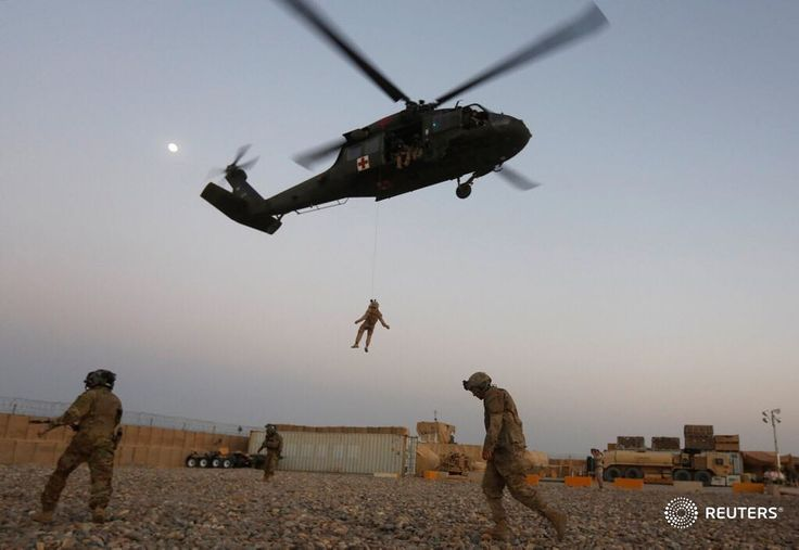 A U.S. Navy Corpsman and U.S. soldier take part in a helicopter Medevac exercise in Helmand province, Afghanistan, July 6, 2017.  REUTERS/Omar Sobhani #reuters #reutersphotos #afghanistan #training #military