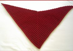 Knitting pattern for a textured ridge pattern triangle shawl.