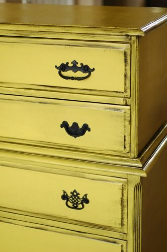 Rescued yellow dresser with mismatched drawer pulls via MakelyHome.com