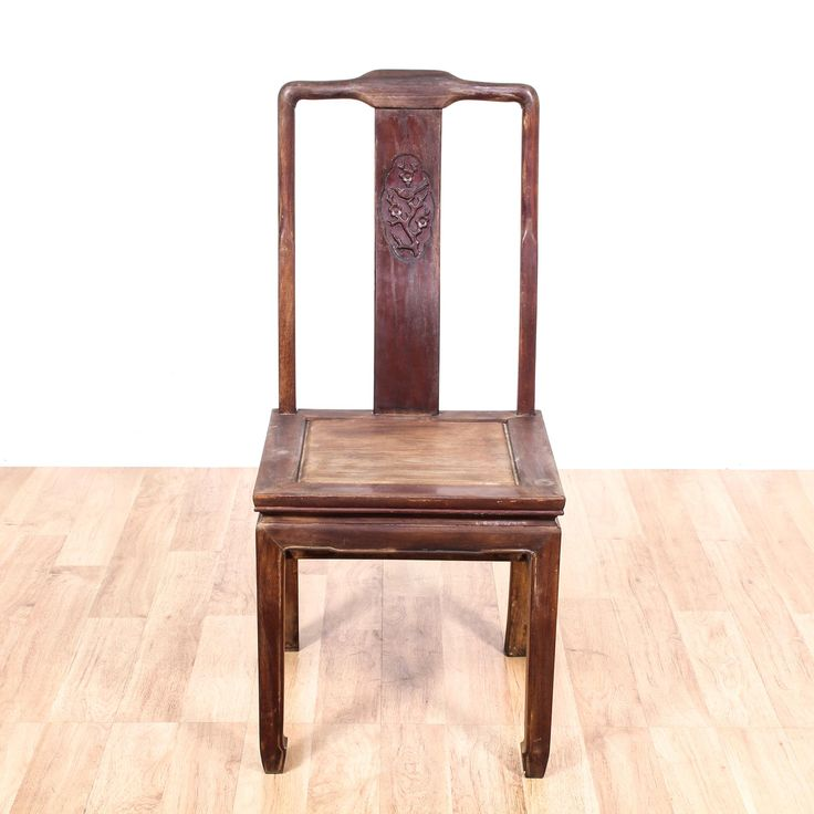 This antique Chinese dining chair is featured in a solid wood with a distressed finish. This side chair has horseshoe feet, h-stretchers, and a bird carved on its splat. Perfect for the dining room! #asian #chairs #diningchair #sandiegovintage #vintagefurniture