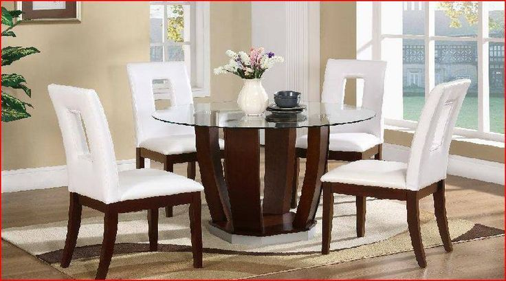 A round glass dining table with majestic chairs for hours of entertainment.
