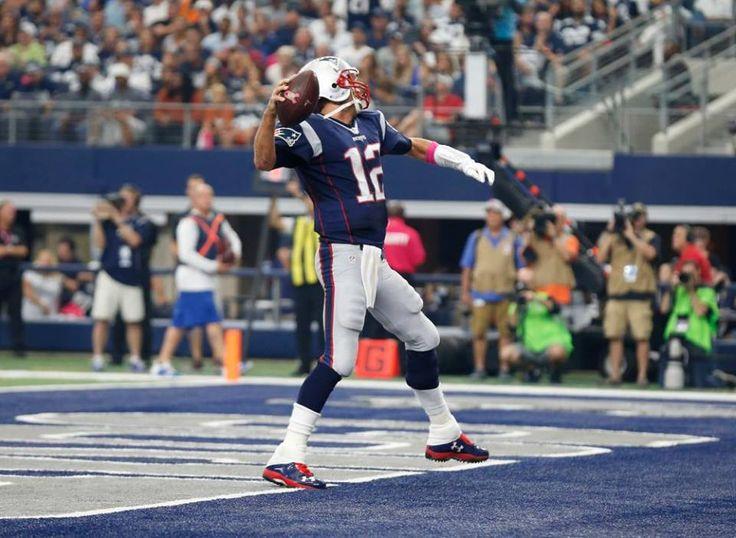 NFL: New England Patriots at Dallas Cowboys   -   Oct 11, 2015; Arlington, TX, USA; New England Patriots quarterback Tom Brady (12) spikes the ball after scoring in the second quarter against the Dallas Cowboys at AT&T Stadium. Mandatory Credit: Matthew Emmons-USA TODAY Sports