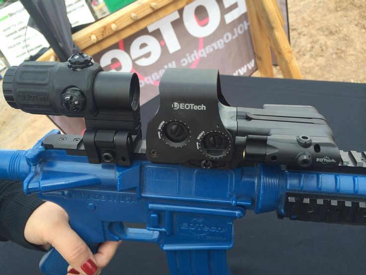 EOTech laser battery compartment.   Turns the 2AA-powered holographic sight into a sight/laser combo. Can retrofit to existing EOTech sights, also.