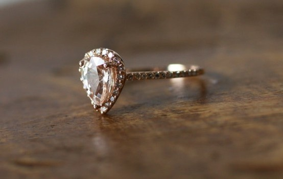 I NEED THIS. peach champagne tear drop sapphire and rose gold diamond ring.