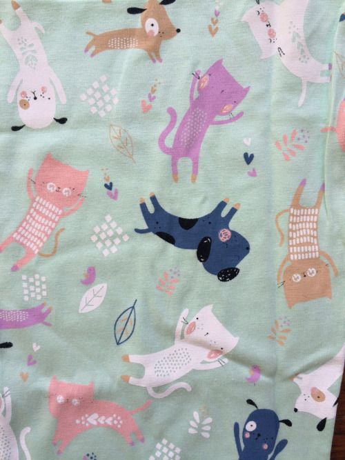 cats and dogs pattern on fabric. Nice for babies and kids.