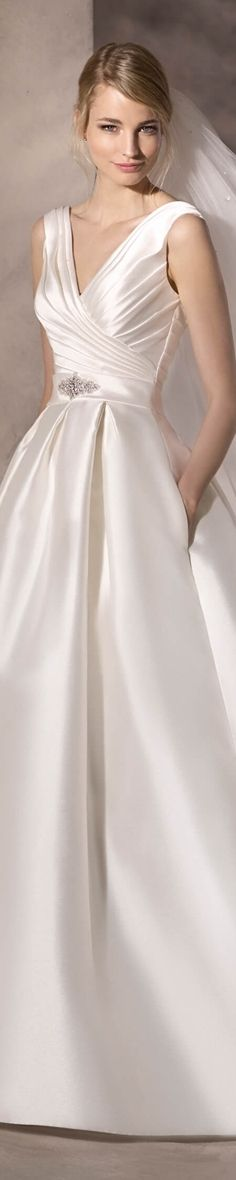 La Sposa Bridal 2017 Haniol Princess dress in kelly mikado. Original V neckline with draped mikado and a simple gemstone detail on the waist that adds a touch of sparkle to the design.