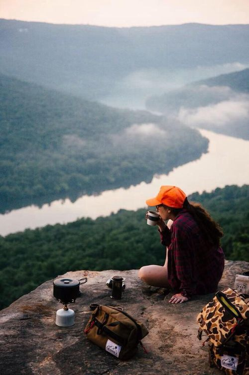 The happiness found from enjoying a warm drink and looking over a winding river, and contemplating life.