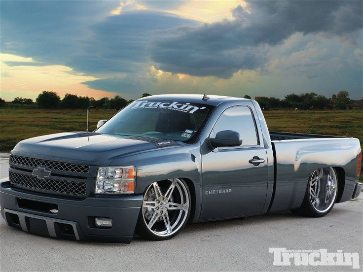 """2007 Chevy Silverado  Lowered on 2"""" spindles for rear and airbags for front Sitting on 24s with 15"""" Baer brakes   With a 6.2 LS3 crate motor with LS9 cam Also has a Whipple supercharger with 9 lbs  boost Producing 680hp"""
