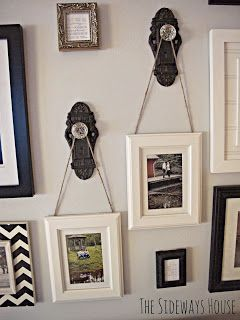 Hang pictures from door knobs... very cool idea!