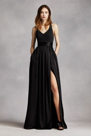An exquisite gown that is perfect for a wedding party or any special event!  V-neck halter gown with matte crepe bodice features bow detail at back.  Long soft charmeuse skirt with middle slit and trapunto-stitched satin sash finishes off the look.  Sizes 0-26.  Fully lined. Back zip. Imported crepe/matte/charmeuse. Dry clean only.