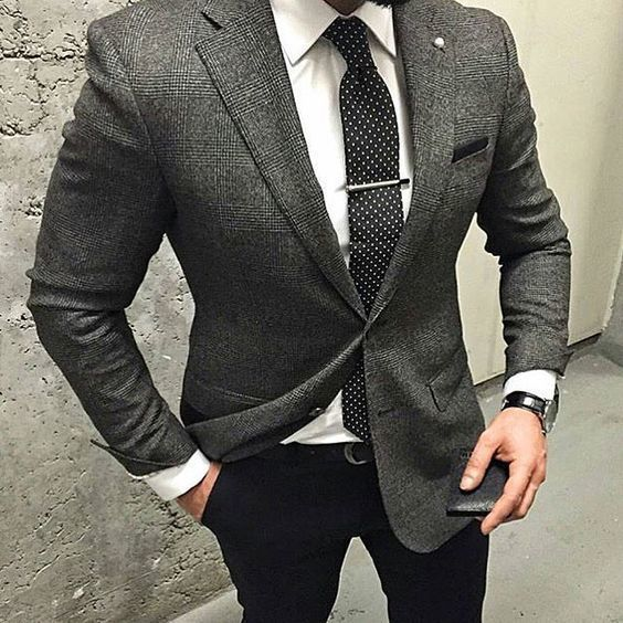 Try teaming a dark grey plaid wool coat with black dress pants for a sharp…