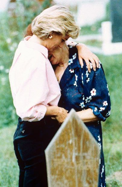 Compassion.......August 1997:  Princess Diana comforts the relative of a person killed by a landmine in Bosnia...Princess Diana was a gift to the world.  She died shortly after this picture was taken.