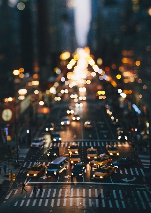the chaos of taxi cabs, street signs and bright lights—the action never stops