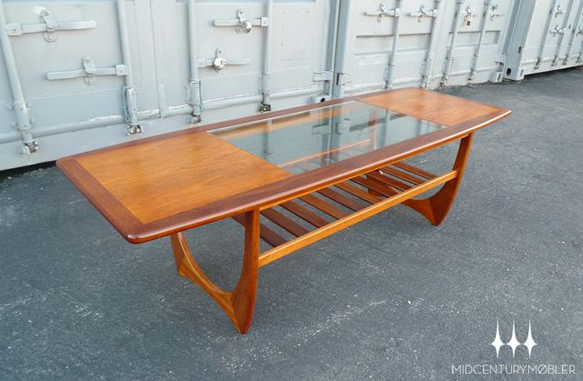 Rare mid century glass + teak surfboard coffee table from G Plan's Astro collection.  Designed by Victor Wilkins.