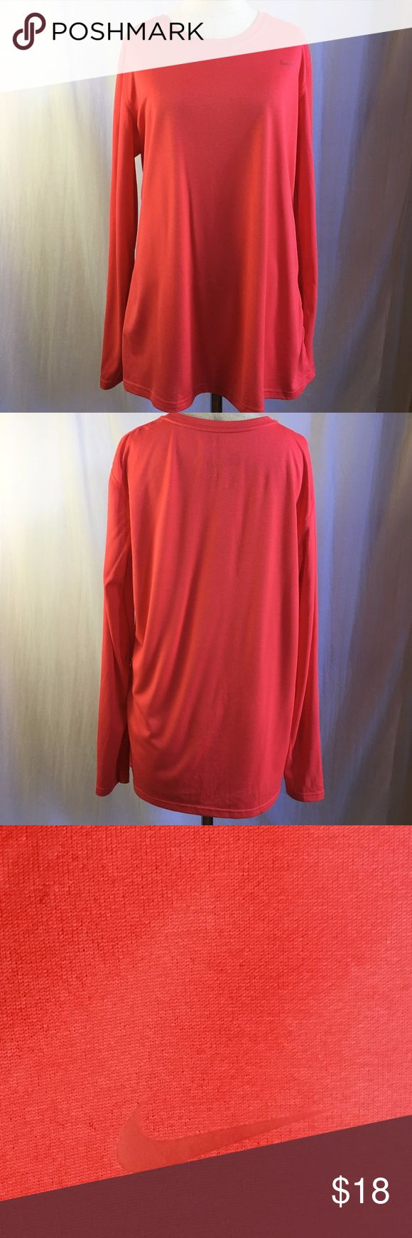 Nike Women's Dri-Fit Pink Long Sleeve Tee sz XL Nike Women's Dri-Fit Pink Long Sleeve Tee sz XL.  Salmon Pink color. Easy and comfortable.  100% Poly. Lightweight. Perfect for any sporting or daily activity. Sku#224107123-15 Nike Tops Tees - Long Sleeve
