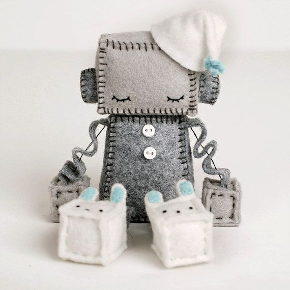 Sleepy Plush Robot in blue is counting sheep in his little night cap and bunny slippers. Looking for a pink sleeping robot? https://www.etsy.com/listing/123983708/sleeping-felt-robot-plush-doll-sleepy?ref=shop_home_active_1 Robot is about 4 inches tall sitting, not including the cap. It is made of premium wool felt, cotton embroidery floss and little plastic buttons. Eyes are embroidered on and the bunnys face is done with French knots. The last image shows a pink robot, but this listing is…
