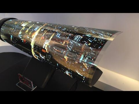 LG OLED TV rolls up like a piece of paper - YouTube