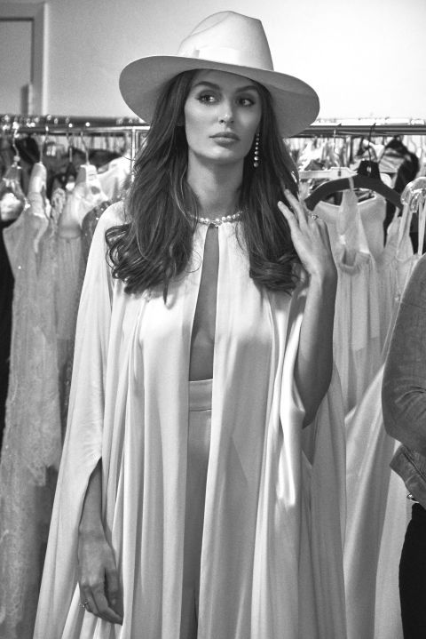 """Australian model Nicole Trunfio channels Bianca Jagger for her rehearsal dinner in this HOUGHTON set: """"Jetta"""" silk cape with Swarovski crystal and pearl collar and matching """"Pearl"""" high waisted wide leg pant. Nicole marries longtime love Gary Clark Jr. this weekend on the anniversary of their first meeting in Coachella."""