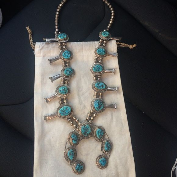 Squash blossom turquoise necklace Squash blossom turquoise necklace. Real sterling silver. Bought at a Native American store in Joshua tree. Can be bought cheaper on ♏️ercari. No low balls, these pieces retail for 1,000s. Jewelry Necklaces